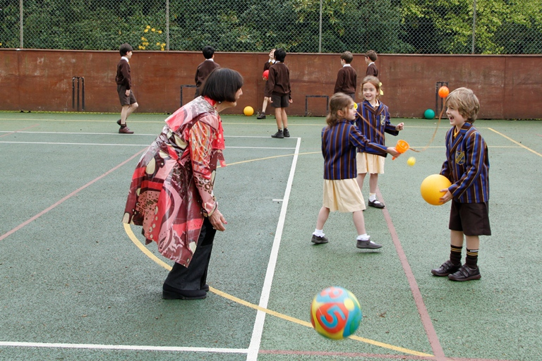 June Brown playing with children